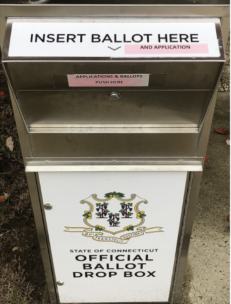 To reduce the potential for COVID-19 spread from in-person voting, many are choosing to vote with absentee ballots. Ballots are mailed in or dropped off in-person in official ballot drop boxes. One is located in the back of Westport's Town Hall.