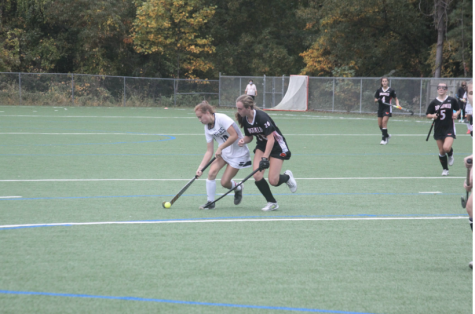 Senior captain Laine Ambrose '21 (left) chases down a ball in a game against Ridgefield. The Boston College commit has been a part of all three of the state champion teams since she arrived at Staples.
