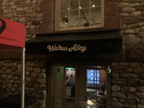 To start your night, you have to walk through the hidden entrance of Walrus Alley.