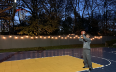 Boys' basketball junior captain Derek Sale '22 practices at his home basketball court. Sale utilizes the court to keep up the work for the postponed season. Sale sometimes hosts his fellow teammates to play some pick up.