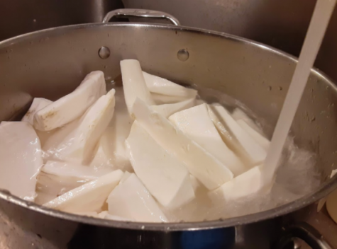 Leaving the wedges to sit in cold water for fifteen minutes helps to remove the excess starch from the yuca.