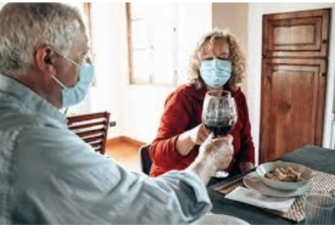 The University of Alabama provides a picture of a couple. Since COVID has not allowed families to gather, this couple enjoys their time without their children and grandkids, hoping to keep the virus away from them.