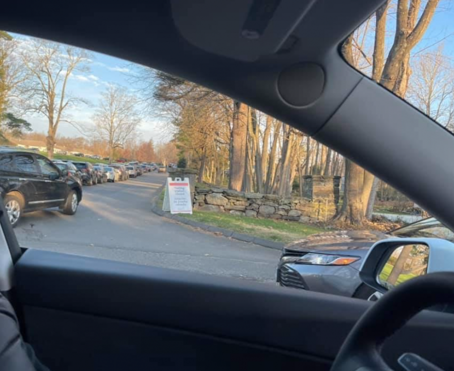 A+long+line+of+cars+waiting+for+COVID-19+testing+at+St.+Vincents+in+Westport.+Staples+is+still+continuing+with+hybrid+learning+despite+the+rising+numbers+of+Covid+cases+in+Connecticut+after+the+holiday+break.+