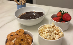 A fondue night will serve as the perfect, simple Valentine's Day activity, satisfying your chocolate cravings within minutes. From popcorn to strawberries to cookies, there's no shortage of things you can dip.
