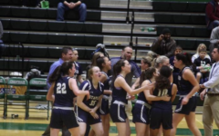 Staples girls' basketball celebrates after upsetting Norwalk on the road.