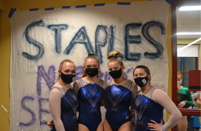 The Wreckers gymnastics team competed in their final home meet of the season on March 18. Seniors (left to right) Chloe Ashton '21, Mia Parkes '21, Sarah Allen '21 and Jamie Hebel '21 have been looking forward to this meet and were relieved it could take place amidst the COVID-19 pandemic.