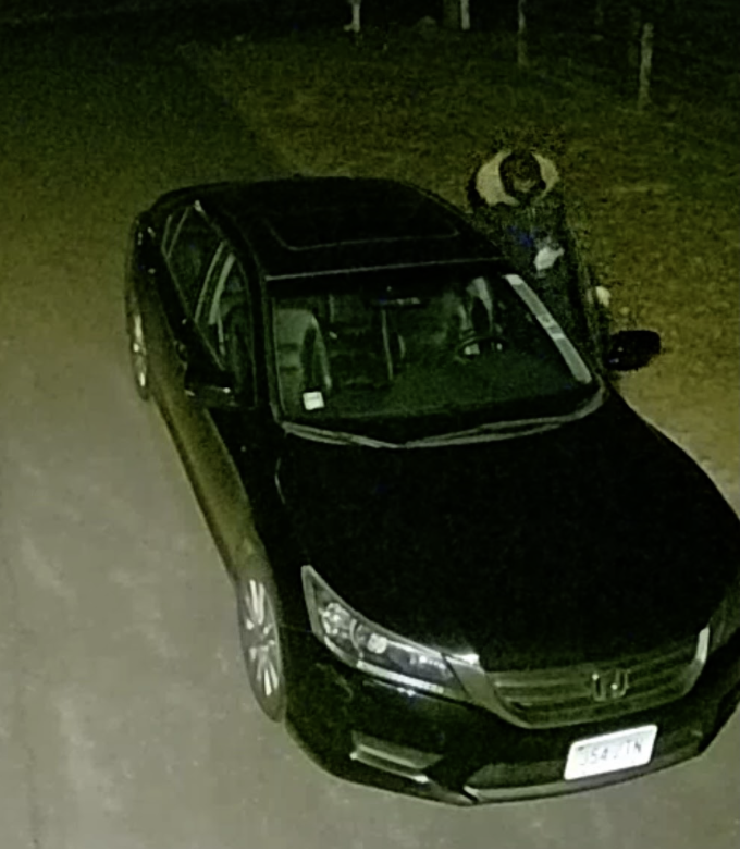 A still image of a Webb Road resident's security camera depicts a car break-in occurring on March 15 at 2:17 a.m.