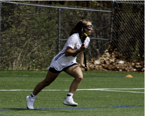 Jess Leon '22 looking to pass the ball in an intense situation during the Staples-Darien game April 30.