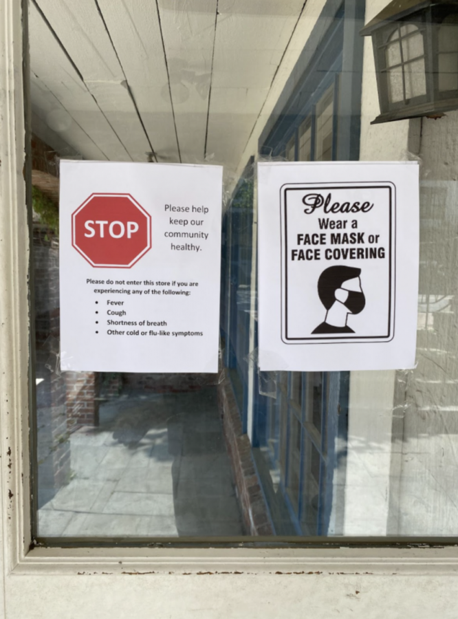 Signs+posted+in+the+windows+of+Brandy+Melville+in+downtown+Westport+show+customers+that+masks+are+still+required+despite+the+recent+CDC+guidelines.