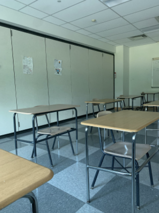 With the seniors gone, the back two rows of AP Economics class are left empty, as all students in the class have moved towards the front to better participate.