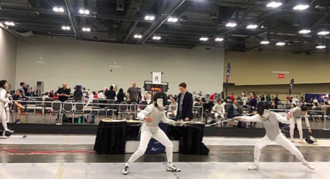 Photo of Anna Pan  '22 fencing for her club team. She is one of the four staples students to bring fencing to staples.