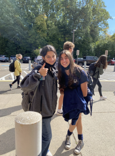 Sophie Spheeris '23 and Finley Cohen '23 take a mask break during their math period, second to last period on Friday.